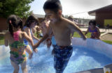 (SHERIDAN, Colo., JUNE 30, 2004)  Pre-school children play in a pool during recess at  the Early...
