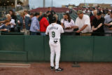 Vinny Castilla signs autographs for Colorado Rockies fans as her makes a return to Colorado,...