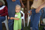 (La Plata County, CO, Shot on 062604) Ellie Tate, 6, is one of seven siblings that came with her...