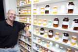 Dave Hill (cq), with a a wall of completed prescriptions in his offices of Belmar Pharmacy, 12860...