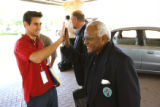 MJM642 The Archbishop Desmond Tutu gives a high-five to Brett Engle (cq), who is the son of Peace...