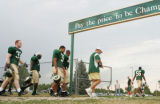 RMN0004 Colorado State University football leave the practice field on the school's campus in Fort...