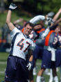 (DENVER, COLO., MAY 7, 2004)   Denver Broncos' #47, John Lynch, stretches out during the team's...