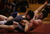 JPM155   Grandview High School wrestler Matt Lucherini, right, tries to roll Eaglecrest High...