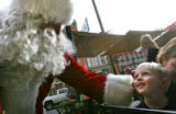 Evan Geary, cq, 4, of Fort Collins turns and sees with surprise, none other than Santa Claus...