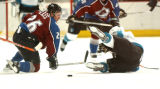 (Denver,CO,Shot On 4/26/04-- Avalanche John-Michael Liles and an unidentified Shark collide in the...
