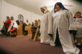 Manuel Orozco (cq), left, dressed as Joseph, and Mireya Molina (cq), right, dressed as Mary, both...