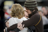 Embracing in group hug in the Main Terminal at Denver International Airport on Thursday December...
