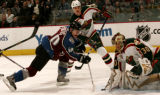 JPM242 - - Colorado Avalanche right wing Marek Svatos, left, drives to the goal but can't get the...