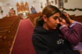Dominique Medina (cq), left, 13, holds her cousin Kinsey Martinez (cq), 3, both of San Francisco,...