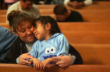 Roberta Romero (cq) hugs her daughter Mariah Medina (cq), 6, at the San Francisco Catholic Church...