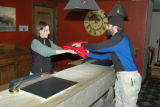 A front desk agent assists a guest at Jackson Hole's Teton Mountain Lodge with equipment from the...
