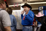(Sunday Jan. 8, 2006) Rick Scaduto, center of Elizabeth, Co.,  explains markings of proposed toll...