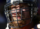 JPM1410 Denver Broncos center Tom Nalen's facemask shows what appears to be a season's worth of...
