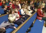 Sitting in the second pew, the Golden family attends Christmas morning church service at Bear...
