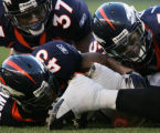 JPM803 Denver Broncos Cecil Sapp, #37, Roc Alexander, #43, and Louis Green, #53, scramble for a...