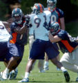 (DENVER, COLO., MAY 7, 2004)   Denver Broncos' #77, Dwayne Carswell, left, and #87, Jed Weaver,...
