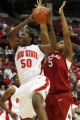 OHTG101 - Ohio State's Jessica Davenport (50) grabs a rebound over Oklahoma's Ashley Paris (5)...