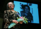 Hazel Johnson Whittsett (cq) co-founder of Northeast Women's Center, is honored with applause  as...