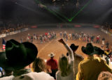 Crowds of Pro Bull Ridding or PBR flock to the Denver Coliseum Tuesday evening Jan. 10, 2006 to...