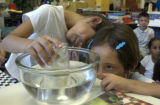 (DENVER, Colo., July 12, 2004) Cassandra Castillo and Aide Marquez, (right)  1st grade graduates ,...
