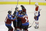 "The Colorado Avalanche's Ian Laperriere (center, with ""A"") celebrates his game winning..."
