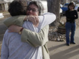 Bonnie Guzman, (cq), receives a hug from Kathleen Orozco, (cq), glasses, upon arriving at her home...