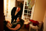 Katherine Cathey and her stepfather Vic Leonard, cq, admire her new baby, James J. Cathey Jr. in...