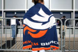 Courtney Baca, cq, Pueblo, waits for her boyfriend to purchase Broncos playoff tickets on...
