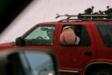Pranksters try to lighten the mood in bumper to bumper trafic along I-70 west as heavy snows...