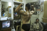 (NYT31) BAGHDAD, Iraq -- Dec. 29, 2005 -- IRAQ-ARNOLD-GYM -- An Iraqi bodybuilder poses in front...
