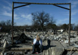 Cheyenne Beaty, 9, sits on what is left of her grandmother's front porch in Cross Plains, Texas on...