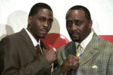 MIPS102 - Boxers Thomas Hearns, right, and his son Ronald are shown at a news conference in Auburn...
