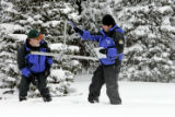 Mike Gillespie (cq), 49, left, and Chris Pacheco, 46, right use a Federal Snow sampler, a 12 ft....