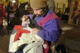 (Tues. Jan. 10, 2006) Roman Alvarado Taglez cleans one of his jackets as he waits fr work at the...