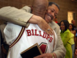 (DENVER, CO.,  JULY 1, 2004) Former Denver Mayor Wellington Webb hugs Detroit Piston and  George...