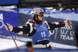 Jeremy Bloom plays to the crowd in the finish area after his second run at the 2006 U.S. Olympic...