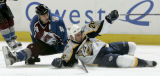 Colorado Avalanche player Rob Blake, left, collides with Nashville Predator player Steve...