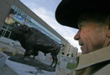 Artist T.D. Kelsey helps install his 3,000 pound bronze North American bison on the North-West...