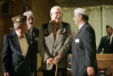 Wayne Dawson (cq), 84, (third from left) of Sheridan, Colo., stands at a guest of honor with...