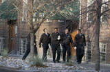 Denver Police recruits and officers search near the alley of the 1400 block of Pennsylvania Street...