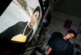 Jairo Guzman, 16, watches an old video tape of his brother Edgar Chocoy in his families two...