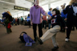 Kate Reagan(cq), of Denver, and her daughter, Tea (accent over the e) Reagan, 6, dance to live...