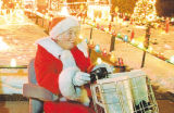 Farewell to a 35-year tradition?  Herman and Lauraine Dinges don Santa and Mrs. Claus outfits as...