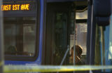 An unidentified man sits inside of an RTD bus that was involved in a fatal accident with a...