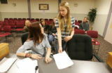 Hannah Frederick, cq, left, a freshman at Adams City High School, talks with her defendant Marina...