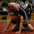 JPM136  Grandview High School wrestler Matt Lucherini, top, works on Eaglecrest High School's A....