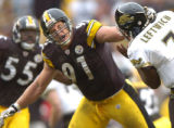 10/16/2005-Pittsburgh Steelers Aaron Smith hits Jaguars quarterback Byron Leftwich in the head and...