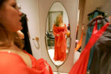 RoxAnne Capstick, 35, of Denver, A downtown real estate broker,  tries on an orange dress at the...