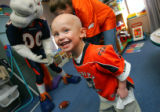Peter Magen, 4, reacts to the crazy antics of the Denver Broncos Miles the Mascot who came to...